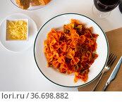 Lazos con tomate, spanish pasta in tomato sauce. Стоковое фото, фотограф Яков Филимонов / Фотобанк Лори