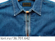 Denim mens shirt with metal front zipper, close up. Стоковое фото, фотограф Zoonar.com/Danko Natalya / easy Fotostock / Фотобанк Лори