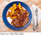 Delicious beef entrecote with fries potatoes. Стоковое фото, фотограф Яков Филимонов / Фотобанк Лори