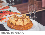 Wedding round loaf and salt macro shot guest greeting custom. Стоковое фото, фотограф Zoonar.com/Olga Sapegina / easy Fotostock / Фотобанк Лори