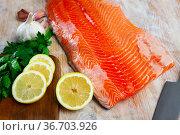 Fresh fillet salmon fish on wooden board. Стоковое фото, фотограф Яков Филимонов / Фотобанк Лори