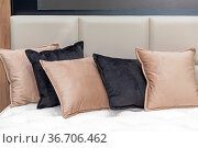 Docorative Plush Pillows and Cushions in Bed. Стоковое фото, фотограф Zoonar.com/Marko Beric / easy Fotostock / Фотобанк Лори
