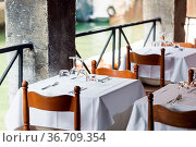 Table setting for a lovey dinner. Empty glasses set in restaurant... Стоковое фото, фотограф Zoonar.com/Konstantin Malkov / easy Fotostock / Фотобанк Лори