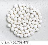 Pile of raw tapioca pearls close up on gray ceramic plate. Стоковое фото, фотограф Zoonar.com/Valery Voennyy / easy Fotostock / Фотобанк Лори