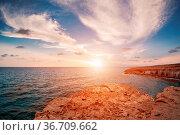Sunset in Cyprus - Mediterranean Sea coast. Sea Caves near Ayia Napa. Стоковое фото, фотограф Zoonar.com/Konstantin Malkov / easy Fotostock / Фотобанк Лори