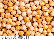 Food background - raw dried whole yellow peas. Стоковое фото, фотограф Zoonar.com/Valery Voennyy / easy Fotostock / Фотобанк Лори
