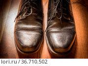 Black Leather Dress Shoes Worn Wooden Floor Sunlight Spotlight Sheen... Стоковое фото, фотограф Zoonar.com/Hunter Bliss / easy Fotostock / Фотобанк Лори