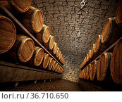 Stocked wine barrels across two sides of corridorof a wine cellar... Стоковое фото, фотограф Zoonar.com/Cigdem Simsek / easy Fotostock / Фотобанк Лори
