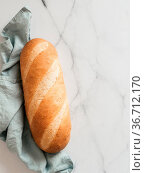 British White Bloomer or European Baton loaf bread on white marble... Стоковое фото, фотограф Zoonar.com/Olga Sergeeva / easy Fotostock / Фотобанк Лори