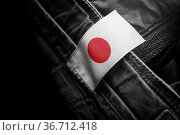 Tag on dark clothing in the form of the flag of the Japan. Стоковое фото, фотограф Zoonar.com/BUTENKOV ALEKSEY / easy Fotostock / Фотобанк Лори