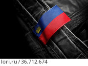 Tag on dark clothing in the form of the flag of the Liechtenstein. Стоковое фото, фотограф Zoonar.com/BUTENKOV ALEKSEY / easy Fotostock / Фотобанк Лори