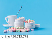 Pile of small colorfull marshmallow on blue background in bowl. Стоковое фото, фотограф Zoonar.com/Photographer: Andrey N.Cherkasov / easy Fotostock / Фотобанк Лори