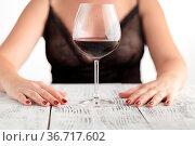 Beautiful woman drinking red wine siting on a sofa. Стоковое фото, фотограф Zoonar.com/Photographer: Andrey N.Cherkasov / easy Fotostock / Фотобанк Лори