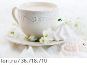 Cup of coffee and pink cherry blossoms on a white background. Стоковое фото, фотограф Zoonar.com/Photographer: Andrey N.Cherkasov / easy Fotostock / Фотобанк Лори