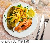 Portion of salmon steak with green pepper and fried potato. Стоковое фото, фотограф Яков Филимонов / Фотобанк Лори