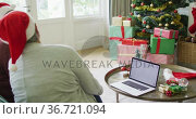Two happy diverse senior woman on video call on laptop with copy space at christmas time. Стоковое видео, агентство Wavebreak Media / Фотобанк Лори