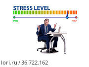 Businessman with meter measuring his stress level. Стоковое фото, фотограф Elnur / Фотобанк Лори