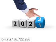 Concept of year 2021 turning to 2022. Стоковое фото, фотограф Elnur / Фотобанк Лори