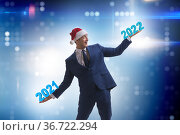 Businessman with new year 2021 to 2022. Стоковое фото, фотограф Elnur / Фотобанк Лори