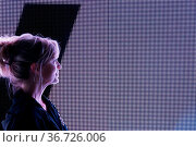 Bright White LED BIllboard Portrait Silhouette Outline Woman. Стоковое фото, фотограф Zoonar.com/LRTimelapse 4.7.1 - UNLICENSED, no comm / easy Fotostock / Фотобанк Лори