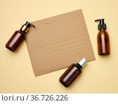 Blank brown sheet of corrugated paper and brown glass bottles with... Стоковое фото, фотограф Natalya Danko / easy Fotostock / Фотобанк Лори