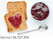 Fried toasts with small spoon and cup of jam. Стоковое фото, фотограф Zoonar.com/Yury Zap / easy Fotostock / Фотобанк Лори