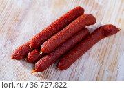 Tyrolean sausages and peppercorns on wooden table. Стоковое фото, фотограф Яков Филимонов / Фотобанк Лори