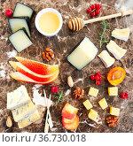 Cheese, honey, nuts and fruits. Plate antipasti snack on marble board. Стоковое фото, фотограф Zoonar.com/Dasha Petrenko / easy Fotostock / Фотобанк Лори