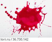 Red ink blot on white background. Стоковое фото, фотограф Яков Филимонов / Фотобанк Лори