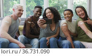 Group of diverse young people showing their vaccinated shoulders and taking a selfie at home. Стоковое видео, агентство Wavebreak Media / Фотобанк Лори