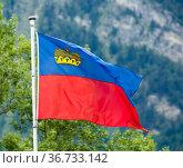 Liechtenstein flag waving on mountain background. Стоковое фото, фотограф Яков Филимонов / Фотобанк Лори