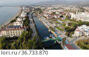 Scenic aerial view of modern cityscape of Fethiye along shoreline of Aegean Sea on sunny winter day, Turkey. Стоковое видео, видеограф Яков Филимонов / Фотобанк Лори
