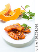 sweet baked grilled pumpkin with seeds in a plate. Стоковое фото, фотограф Peredniankina / Фотобанк Лори