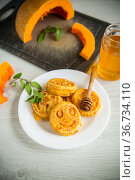 sweet lush pumpkin pancakes with honey in a plate. Стоковое фото, фотограф Peredniankina / Фотобанк Лори