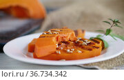Hot with steam sweet baked grilled pumpkin with seeds. Стоковое видео, видеограф Peredniankina / Фотобанк Лори
