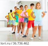 Focused tween children standing in row one by one, learning folk dance. Стоковое фото, фотограф Яков Филимонов / Фотобанк Лори