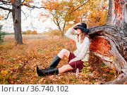 Beautiful girl in the autumn forest. Beautiful young girl with long... Стоковое фото, фотограф Zoonar.com/Konstantin Malkov / easy Fotostock / Фотобанк Лори
