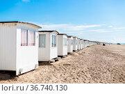 Lokken, Denmark - July 19, 2019: White beach cabins at the sand beach... Стоковое фото, фотограф Zoonar.com/Oliver Foerstner / easy Fotostock / Фотобанк Лори