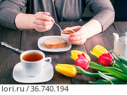 Woman hands buttering bread with cup of tea. Стоковое фото, фотограф Zoonar.com/Photographer: Andrey N.Cherkasov / easy Fotostock / Фотобанк Лори