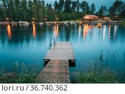 Sweden. Beautiful Wooden Pier Near Lake In Summer Evening Night. Lake... Стоковое фото, фотограф Ryhor Bruyeu / easy Fotostock / Фотобанк Лори