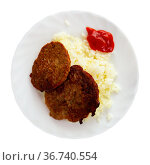 Traditional dish of Russian cuisine is cutlets with rice. Стоковое фото, фотограф Яков Филимонов / Фотобанк Лори