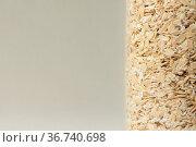 Corn flakes close-up on beige background colored. Стоковое фото, фотограф Александр Новиков / Фотобанк Лори