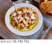 Chicken Caesar salad with tomatoes and cheese. Стоковое фото, фотограф Яков Филимонов / Фотобанк Лори