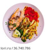 Portion of salmon steak with red pepper and fried potato. Стоковое фото, фотограф Яков Филимонов / Фотобанк Лори