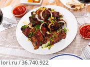 Barbecued pork shashlik with onion and herbs. Стоковое фото, фотограф Яков Филимонов / Фотобанк Лори