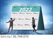 Businessman in the calendar concept of year 2022. Стоковое фото, фотограф Elnur / Фотобанк Лори