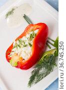 Stuffed half of pepper with brynza, dish of Bulgarian cuisine. Стоковое фото, фотограф Яков Филимонов / Фотобанк Лори