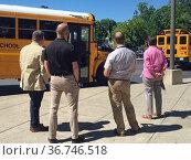 School Administrators Watching Buses Leave on Last Day of School, ... Редакционное фото, фотограф bfanton / age Fotostock / Фотобанк Лори