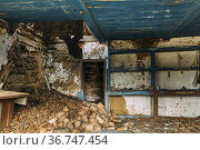 Abandoned Ruined Old Wooden Village House In Chernobyl Resettlement... Стоковое фото, фотограф Ryhor Bruyeu / easy Fotostock / Фотобанк Лори