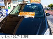Protaras, Cyprus - Oct 6. 2019. Car hire available - sign with inscription on car glass. Редакционное фото, фотограф Володина Ольга / Фотобанк Лори